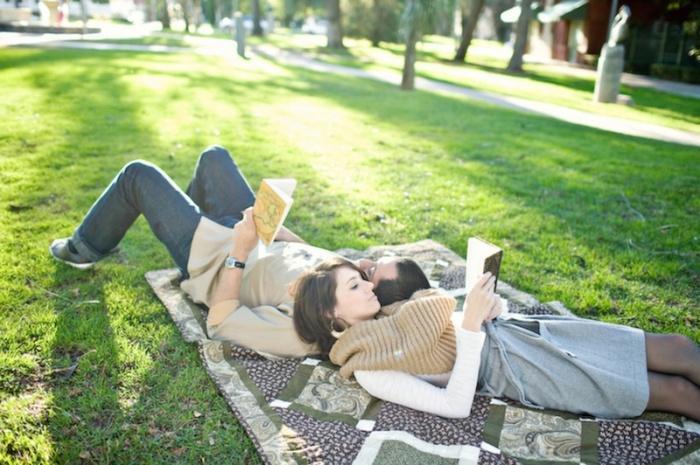 18-couple-lying-reading-blanket-fall-outside